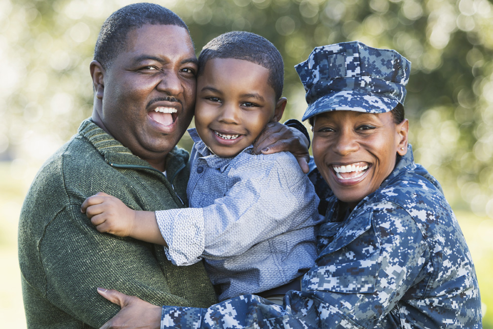 military female with husband and son